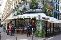 The cafe de Flore decorated for Christmas ,Paris, France. Paris France-November 26 , 2017 :The famous cafe De Flore decorated for Christmas located at the royalty free stock photo