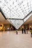 Paris France, November 2014: Holiday in France - The Louvre during winter Christmas. The Louvre Museum is the world`s largest museum and a historic monument in royalty free stock photo