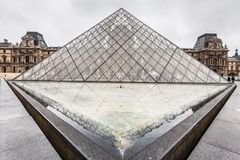 Paris France, November 2014: Holiday in France - The Louvre during winter Christmas. The Louvre Museum is the world`s largest museum and a historic monument in stock photography