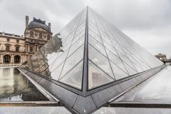 Paris France, November 2014: Holiday in France - The Louvre during winter Christmas. The Louvre Museum is the world`s largest museum and a historic monument in stock photos