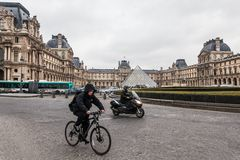 Paris France, November 2014: Holiday in France - The Louvre during winter Christmas. The Louvre Museum is the world`s largest museum and a historic monument in stock photo