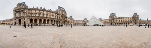 Paris France, November 2014: Holiday in France - The Louvre during winter Christmas. The Louvre Museum is the world`s largest museum and a historic monument in stock images