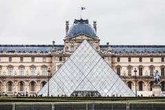 Paris France, November 2014: Holiday in France - The Louvre during winter Christmas. The Louvre Museum is the world`s largest museum and a historic monument in royalty free stock photography