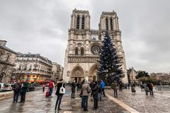 Paris France, November 2014: Holiday in France - Notre-Dame Cathedral and tourist during winter Christmas. Notre-Dame Cathedral and tourist during winter stock photography