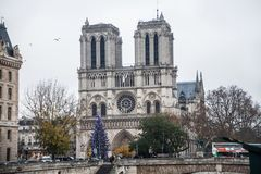 Paris France, November 2014: Holiday in France - Notre-Dame Cathedral and tourist during winter Christmas. Notre-Dame Cathedral and tourist during winter royalty free stock photos