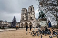 Paris France, November 2014: Holiday in France - Notre-Dame Cathedral and tourist during winter Christmas. Notre-Dame Cathedral and tourist during winter royalty free stock photography