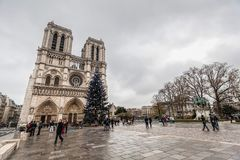 Paris France, November 2014: Holiday in France - Notre-Dame Cathedral and tourist during winter Christmas. Notre-Dame Cathedral and tourist during winter stock photo