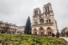 Paris France, November 2014: Holiday in France - Notre-Dame Cathedral and tourist during winter Christmas. Notre-Dame Cathedral and tourist during winter royalty free stock image