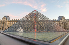 PARIS, FRANCE – 29 NOVEMBER, 2014: Louvre in the sunrise Stock Photos