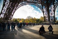 PARIS, FRANCE - NOVEMBER 11, 2014 People, mainly tourists queuin Stock Photos