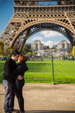 PARIS, FRANCE - NOVEMBER 9, 2014 Young Asian couple kissing in f Stock Image