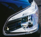 BMW Adaptive Xenon LED headlight detail. PARIS, FRANCE - OCT 15, 2018: BMW Adaptive Xenon LED headlight detail on a blue luxury limousine stock photos