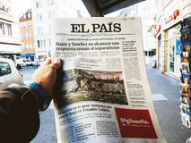 2017 Las Vegas Strip shooting El Pais newspaper. PARIS, FRANCE - OCT 3, 2017: Man buying Spanish El Pais  newspaper with socking title and photo at press kiosk Royalty Free Stock Photo