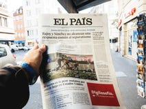 2017 Las Vegas Strip shooting El Pais newspaper. PARIS, FRANCE - OCT 3, 2017: Man buying Spanish El Pais  newspaper with socking title and photo at press kiosk Stock Image