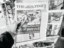 2017 Las Vegas Strip shooting newspaper the times pue evil. PARIS, FRANCE - OCT 3, 2017: Man buying The Times newspaper with socking title and photo at press Stock Image