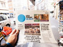 2017 Las Vegas Strip shooting newspaper USa today. PARIS, FRANCE - OCT 3, 2017: Man buying USA Today newspaper with socking title and photo at press kiosk about Stock Photography
