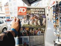 2017 Las Vegas Strip shooting algemeen dagblad newspaper. PARIS, FRANCE - OCT 3, 2017: Man buyingDutch algemeen dagblad newspaper with socking title and photo at Royalty Free Stock Photo
