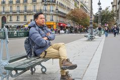 A man sitting on vintage bench stock images