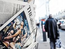 2017 Las Vegas Strip shooting newspaper The Times people. PARIS, FRANCE - OCT 3, 2017: Pedestrians near the Times newspaper with socking title and photo at press Stock Image