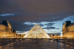 Paris, France - OCT 2016. Pyramid of the Louvre Art Museum, famous historical architectural landmark at night. Popular. Touristic places and travel destinations Stock Photos