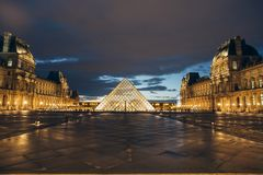Paris, France - OCT 2016. Pyramid of the Louvre Art Museum, famous historical architectural landmark at night. Popular Stock Photos
