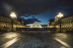 Paris, France - OCT 2016. Pyramid of the Louvre Art Museum, famous historical architectural landmark at night. Popular Royalty Free Stock Photos