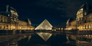 Paris, France - OCT 2016. Pyramid of the Louvre Art Museum, famous historical architectural landmark at night. Popular Royalty Free Stock Image