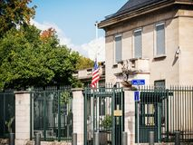 2017 Las Vegas Strip shooting newspaper. PARIS, FRANCE - OCT 3, 2017: US United States American Flag flying half-mast in court of the US Embassy after the 2017 Royalty Free Stock Photo