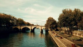 PARIS, FRANCE - OCTOBER 8, 2017. Aerial shot of romantic Seine river embankment on a sunny autumn day stock video