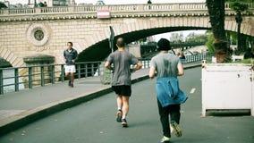 PARIS, FRANCE - OCTOBER 8, 2017. Amateur runners run along the Seine river embankment. PARIS, FRANCE - OCTOBER 8, 2017. Amateur runners run along the river stock photo