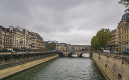 PARIS, FRANCE - 02 OCTOBER 2018: Beautiful Seine river on cloudy autumn day stock photography