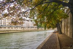 PARIS, FRANCE - 02 OCTOBER 2018: Beautiful Seine river on cloudy autumn day stock photo