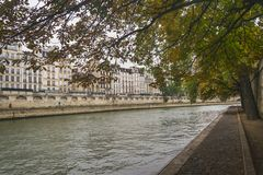 PARIS, FRANCE - 02 OCTOBER 2018: Beautiful Seine river on cloudy autumn day royalty free stock photography
