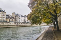 PARIS, FRANCE - 02 OCTOBER 2018: Beautiful Seine river on cloudy autumn day stock photos