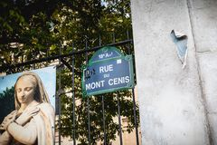Blue street sign where it is written 18th arrondissement Mont Ce royalty free stock photography