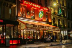 The famous brasserie Lipp at night , Paris, France. Stock Photos