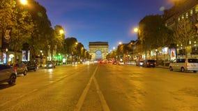 Arc de triomphe, Paris, France. Paris, France - October 06, 2017: car driving in front of Arc de Triomphe illuminated at night, Paris, France stock footage