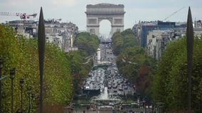 PARIS, FRANCE - OCTOBER 8, 2017. Car traffic near famous Arc de Triomphe or Triumphal Arch, telephoto lens shot. PARIS, FRANCE - OCTOBER 8, 2017. Traffic near Royalty Free Stock Photography