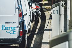 A commerical electric vehicle van uses a charging station. PARIS, FRANCE - OCTOBER 05, 2016: A commerical electric vehicle van uses a charging station royalty free stock photography