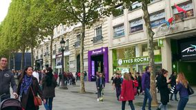 PARIS, FRANCE - OCTOBER 7, 2017. Famous Champs-Elysees street sidewalk and storefronts stock photography