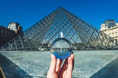 Famous Louvre Museum Pyramid through the crystal ball, Paris, France royalty free stock photography