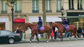 PARIS, FRANCE - OCTOBER 7, 2017. French mounted gendarmes patrol the city center Royalty Free Stock Photo