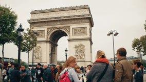 PARIS, FRANCE - OCTOBER 8, 2017. Many tourists walk near famous Arc de Triomphe or Triumphal Arch Stock Image