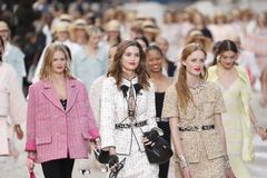 Models walk the runway finale during the Chanel show as part of the Paris Fashion Week Womenswear Spring/Summer 2019. PARIS, FRANCE - OCTOBER 02: Models walk the royalty free stock images