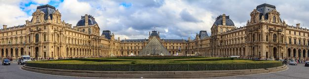 Panoramic view of the facade of the famous Louvre Museum, one of the world`s largest art museums and a historic monument in Paris stock photo