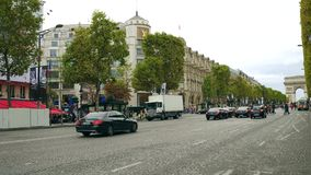 PARIS, FRANCE - OCTOBER 8, 2017. Road traffic on Champs-Elysees street towards Arc de Triomphe or Triumphal Arch. PARIS, FRANCE - OCTOBER 8, 2017. Road traffic Stock Photo