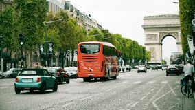 PARIS, FRANCE - OCTOBER 8, 2017. Road traffic on Champs-Elysees street towards famous Arc de Triomphe or Triumphal Arch. PARIS, FRANCE - OCTOBER 8, 2017. Road Stock Photos