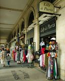 Souvenir shops line Rue de Rivoli across from the Louvre in Paris stock photos