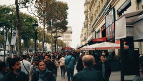 PARIS, FRANCE - OCTOBER 7, 2017. Walk along crowded Champs-Elysees street sidewalk towards Arc de Triomphe or Triumphal Royalty Free Stock Image