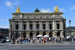 Paris, France. Opera Garnier, Palais Garnier. August 2018. Period movie filmmaking and tourists crowding the monument. stock image